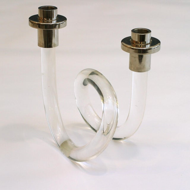 1960's candlestick attributed to designer Dorothy Thorpe in lucite. There is some minor cracking to the bases, in a good...