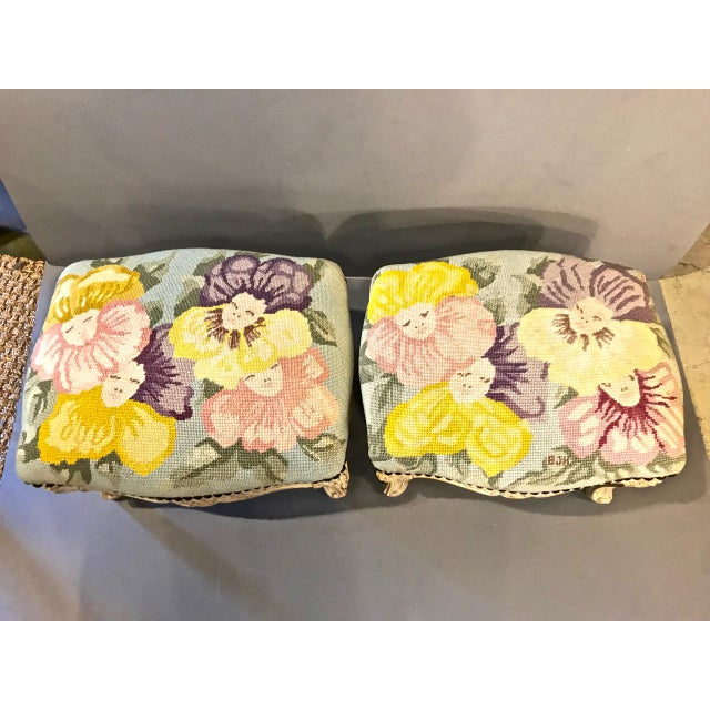 This is a unique associated pair of 18th and 19th century footstools that have been upholstered in a super chic and signed...