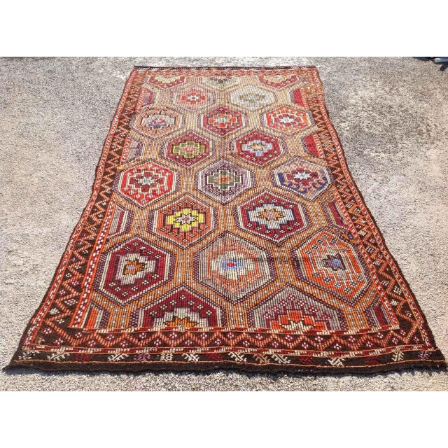 This beautiful, vintage, handwoven kilim is approximately 60 years old. It is handmade of very fine quality wool and goat...