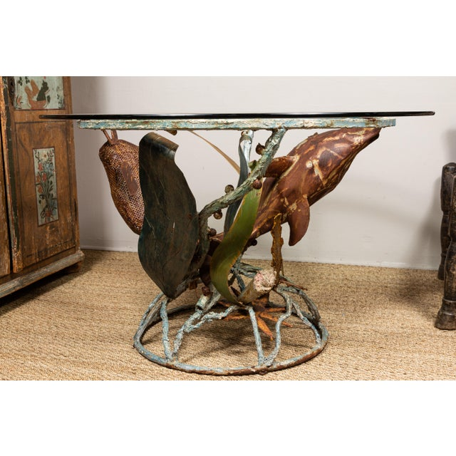 Unusual sculptural wrought iron table base with glass top. Underwater scene with dolphin, star fish, etc. Rusted...