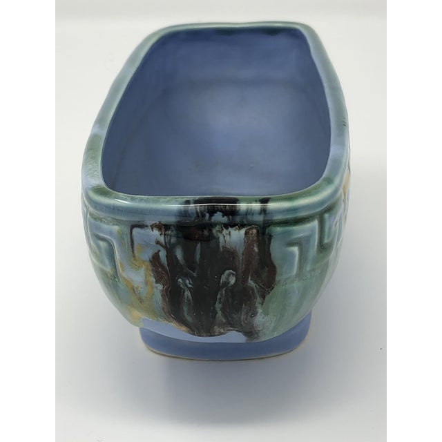 This rectangle shaped window planter or cachepot has a beautiful Greek key border to the rim. It is glazed in a light aqua...