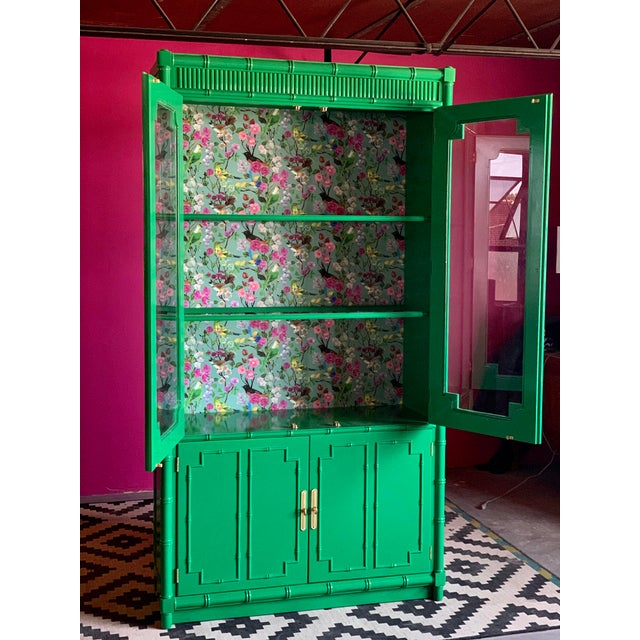 Stunning china cabinet lacquered in glossy Bold Green. The back is wallpapered in special bird paper. This is a beauty!