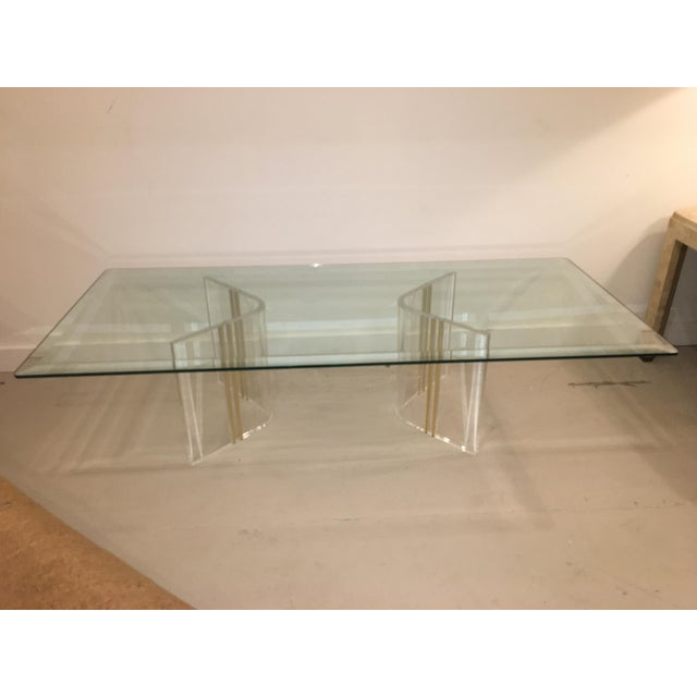 Lucite base cocktail table with glass top.