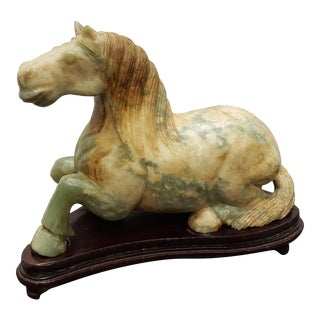 Vintage Circa 1960 Chinese Recumbent Horse Mottled Celadon Jade Carving on a Wood Stand - 2 Pieces For Sale