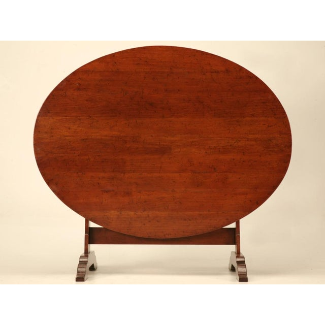Incredible vintage cherry wood tilt-top wine table. Unusually large, this fine table is perfect for daily use as a...