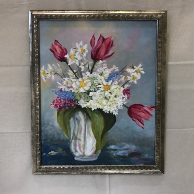 """Pink tulips, daffodils, and greenery in a white vase are pictured in this spring floral study. 21""""x 25"""" oil on canvas..."""