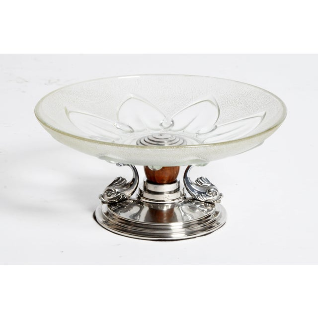 This elegant glass candy dish is from Paris, France and is made from glass and metal, c. 1960.