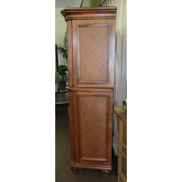 New in our showroom is this fabulous Drexel Cabinet. Featuring a cross design in split bamboo cabinet above 4 full sized...
