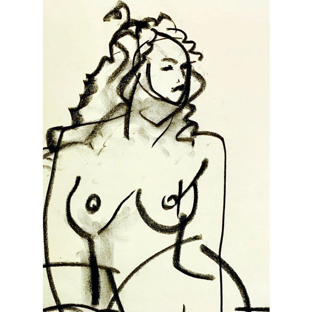 Drawing from the model - gesture drawing of the beauty of a woman in charcoal on newsprint.