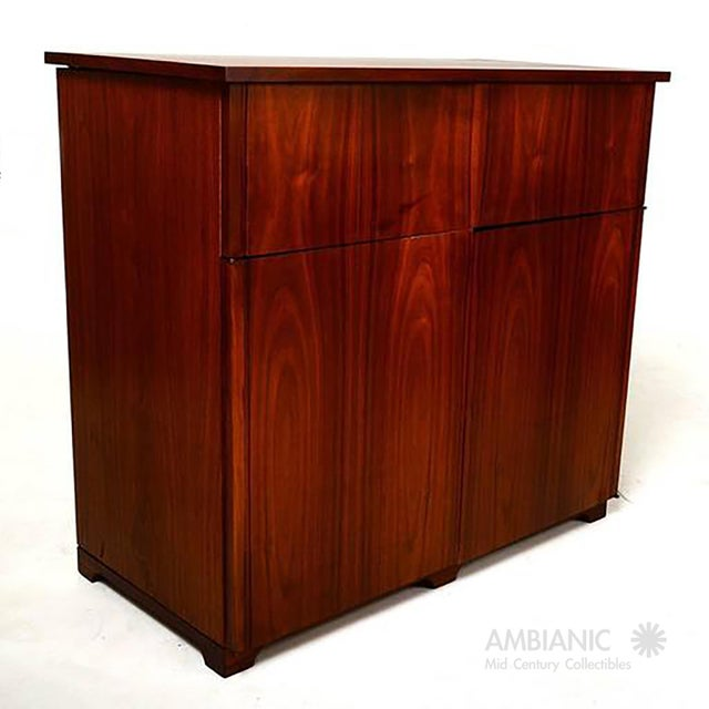 For your consideration a Mid-Century Modern cabinet with built in desk. The top section can be lifted to display an open...