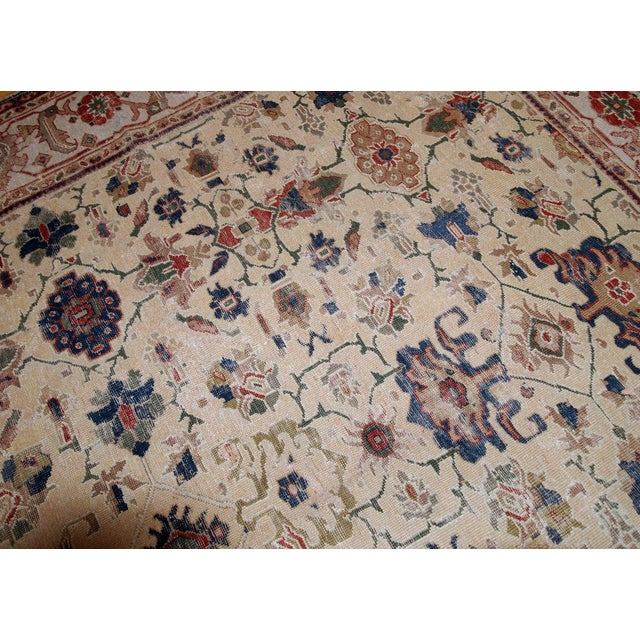 Hand made antique Mahal rug in egg shell shade and in distressed condition. The rug is from the beginning of 20th century....