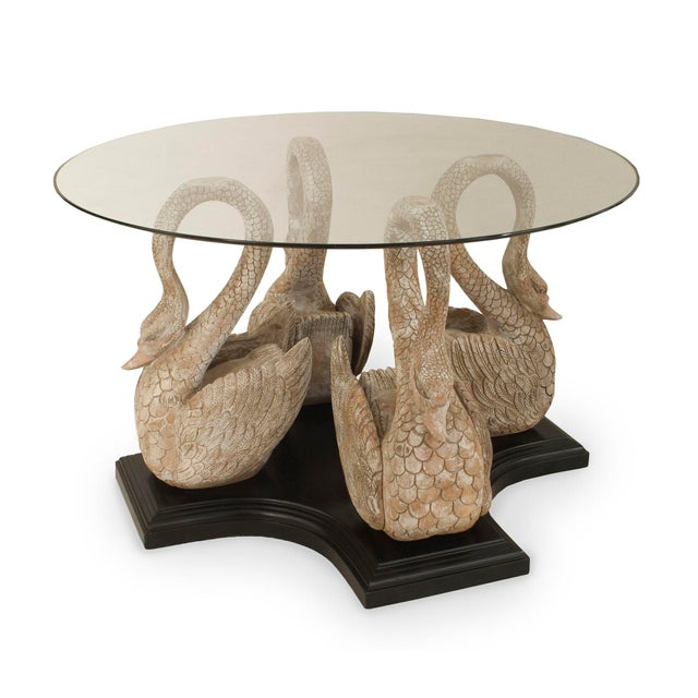 English Country style (19/20th Cent) center table with 4 carved and bleached swans resting on an ebonized base supporting...