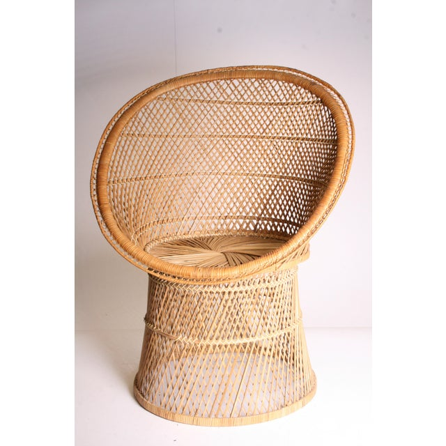 Vintage Wicker Chair. Chair can hold a lot of weight. Rounded design. Great condition; light wear around edges. Total...