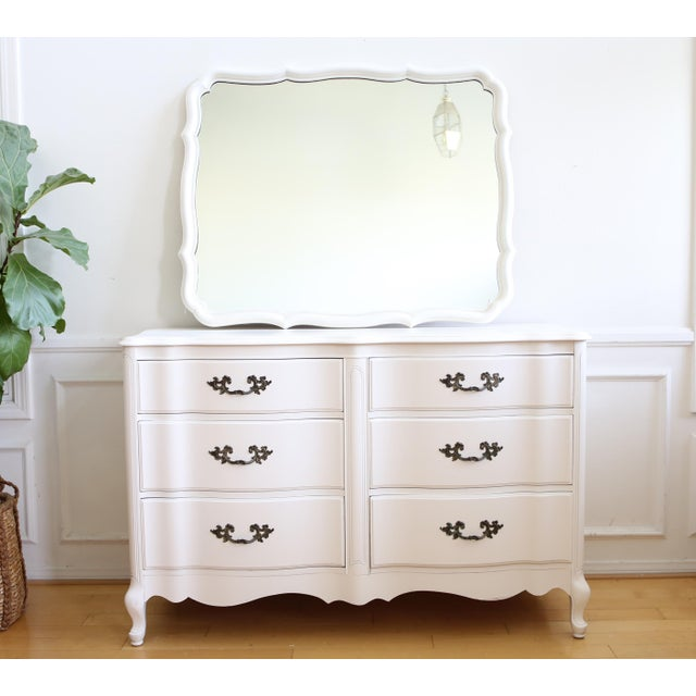 French provincial dresser / credenza with 6 drawers and a mirror. This french provincial dresser featured in a solid wood...