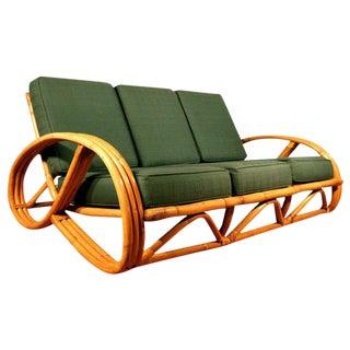 Restored Paul Frankl Style Round Pretzel Arm Rattan Sofa For Sale