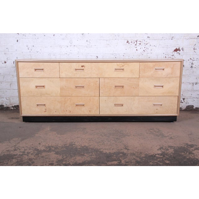 An exceptional burl wood long dresser or credenza from the Scene Two Collection by Henredon. The dresser features a...