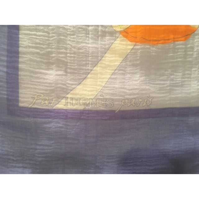 This lovely Hermes Silk Chiffon Scarf is hard to find and very collectible. Au Clair de la Mer has a blue background and...