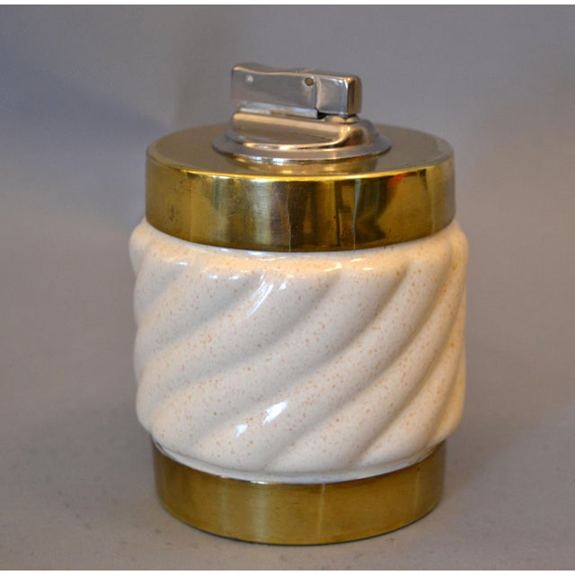 Mid-Century Modern chic ceramic and brass lighter in beige made in Italy. Signed underneath: Tommaso Barbi, made in Italy....