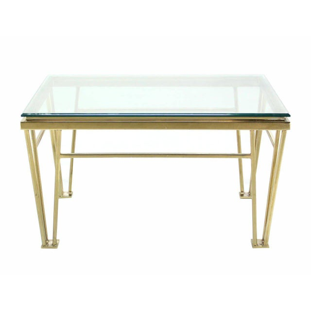 Unusual mid century modern design brass side lamp or end table with glass top.