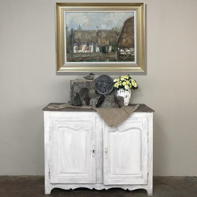 18th Century Country French Provincial Painted Buffet boasts tailored, elegant lines that combine with the distressed...