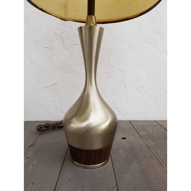 A Tony Paul design table lamp manufactured by Laurel Lamp Company, circa. 1960. Polished nickel finish and Amphora form...