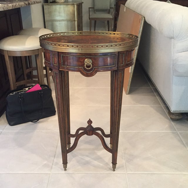 A cerejeira Lamp Table with fine brass mounts, the brass galleried oval top a frieze drawer on paneled square tapering...