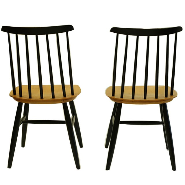 Price is per chair May be sold separately Pair of teak and black lacquered dining chairs by Imari Tapiovaara. Made in Sweden.
