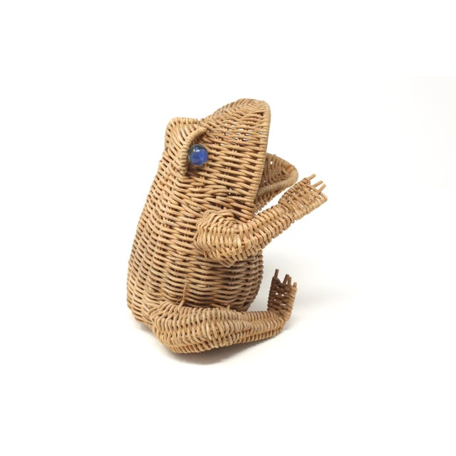 A vintage wicker basket or figure in the form of a frog, with glass marble eyes. Good vintage condition; minor wear...
