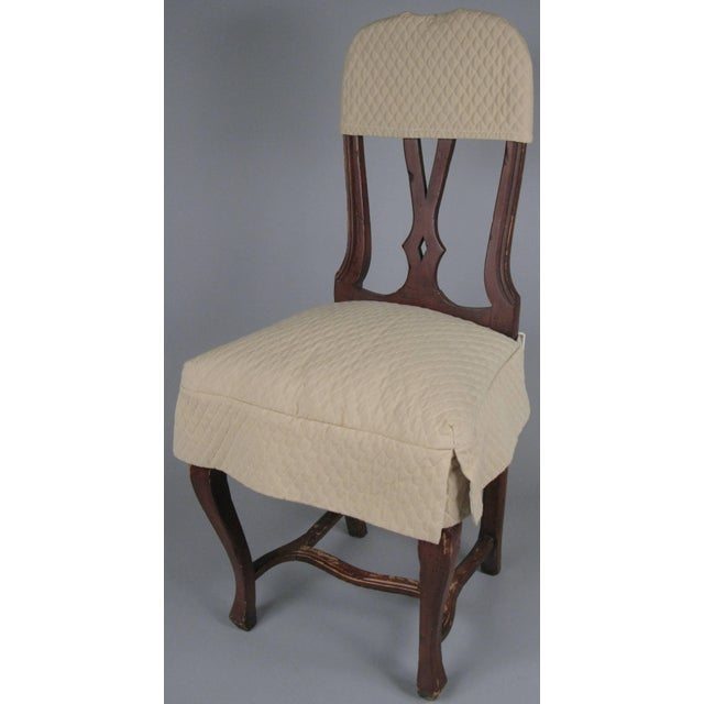A nice set of eight vintage 1960s Swedish rococo style painted wood dining chairs, with woven cane seats. The entire set...