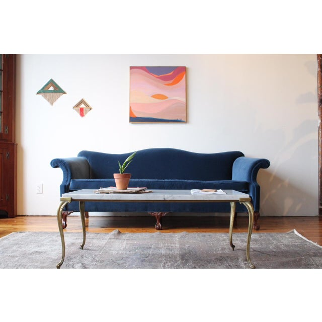 Newly reupholstered antique camelback chippendale sofa. Professionally reupholstered in Robert Allen navy blue cotton...