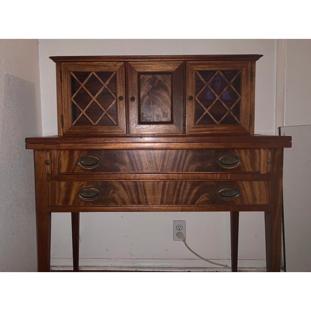 Desk is in very very good condition! There is a small ding on the edge of the desk which is also the underside of the...
