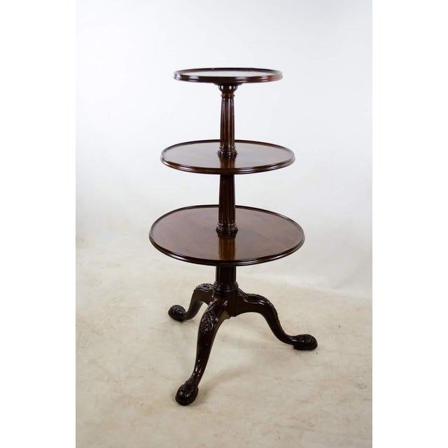 Easily serve and entertain a large gathering of guests with this late 19th c. Georgian 3-tier dumbwaiter table. The 3...