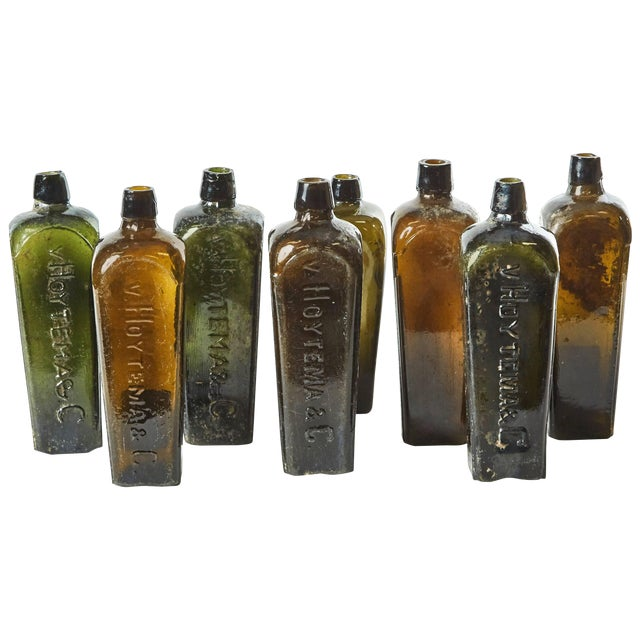 Set of 8 Multi-Color Gin Glass Bottles From Mid-Century Germany For Sale