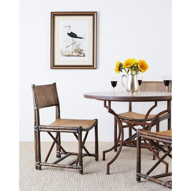 Extraordinary set of eight McGuire organic modern style dining chairs. Rare design featuring a bamboo rattan frame made in...
