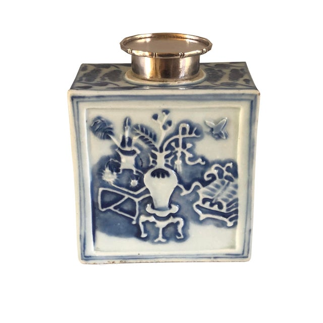 18th century Chinese molded blue and white tea caddy with sacred objects.