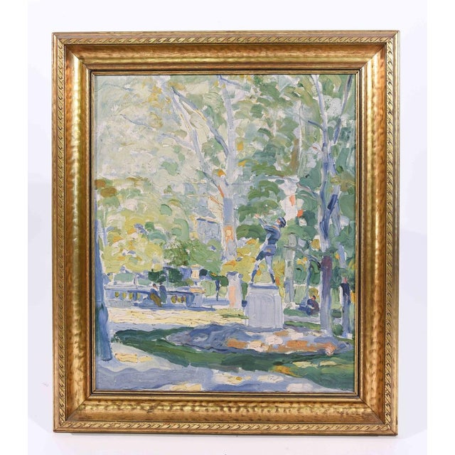 An American Impressionist oil painting of a park scene, early 20th Century, signed lower right. By C. Lay. Set in gilt...