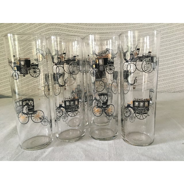 A set of 8 mid century modern Libbey clear glass tumblers decorated with various styles of carriages in black and gold....