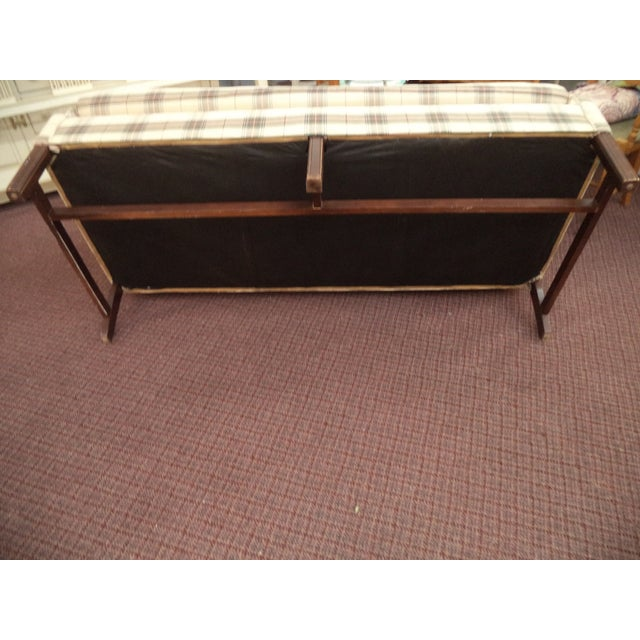 Quality Paul Robert Chippendale style camel back sofa in very, very good condition. The sofa features a mahogany wood...