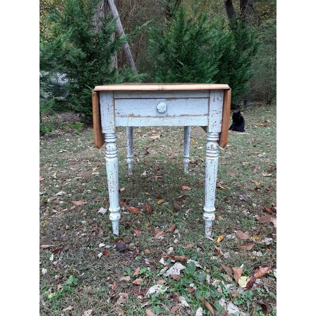 Item offered is an antique 1800's pine and painted distressed farmhouse kitchen table with one drawer and nice turned...