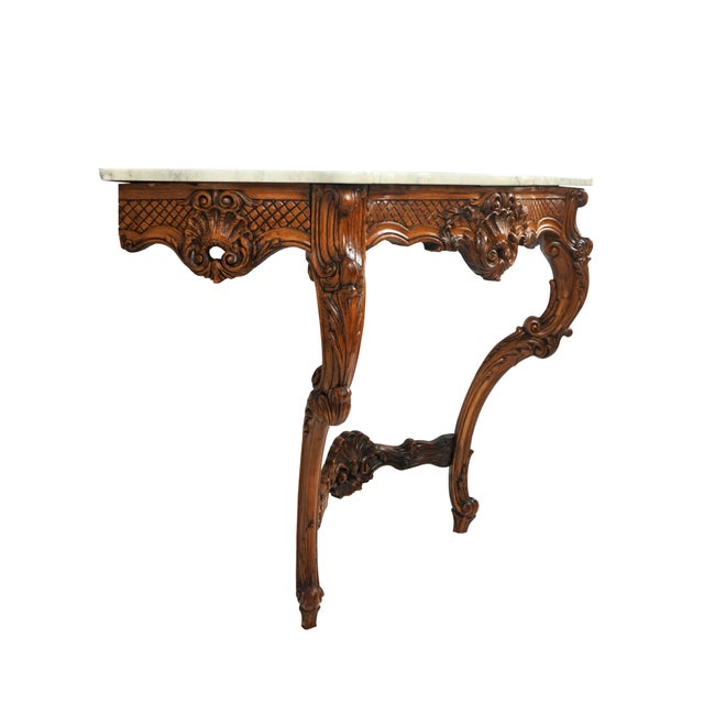 Antique French Louis XV Rococo Italian wall mounted console table. Hand-carved acanthus scrollwork throughout featuring...