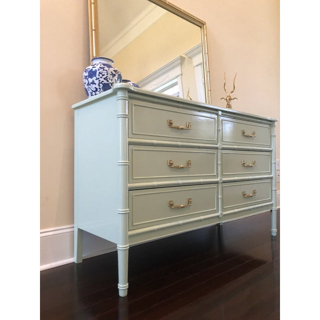 Gorgeous Faux Bamboo 6 drawer dresser. Painted in high gloss mint green with original brass hardware. This fabulous...