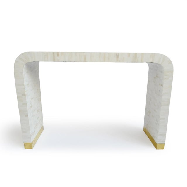 Beautiful modern natural white bone inlay waterfall console table with brass trim base. Old world technique with a modern...