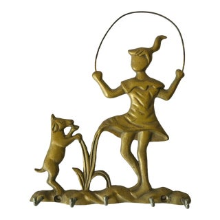Brass Hanger Featuring Figure of Girl Jumping Rope With Dog For Sale