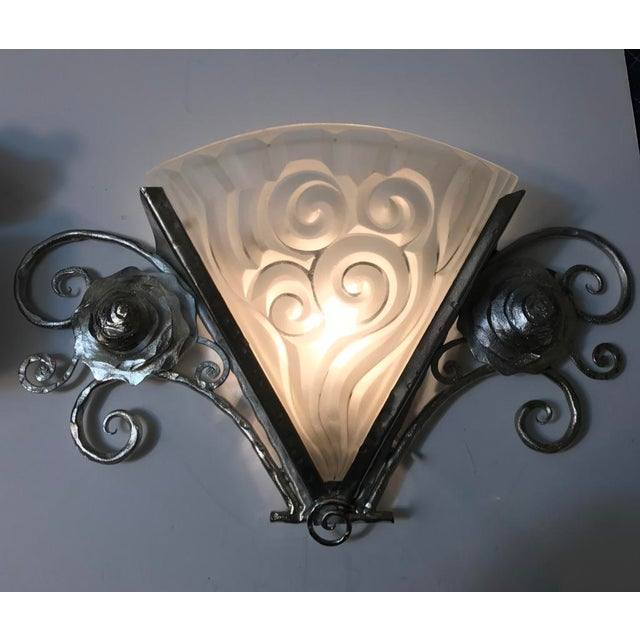 "Stunning pair of French Art Deco wall sconces by the French artist ""Degue"" in clear frosted glass shades with geometric..."