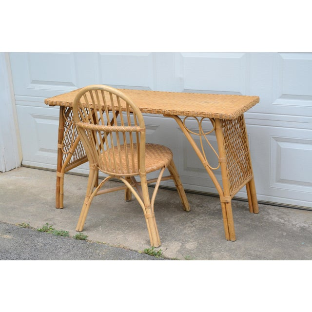 1950s Wicker/Rattan desk and chair set. They are sturdy and set evenly on the ground. Most of the wicker is intact with...