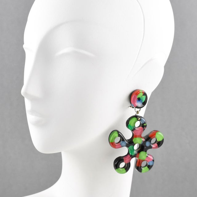 Stunning Lucite or Resin dangling clip on earrings. Typical 'Flower Power' style, oversized stylized floral shape, carved...