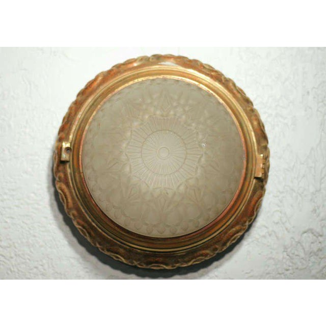 An original 1940s bronze dome ceiling or wall light fixture or sconce complete with original frosted shade. Up to 12 are...