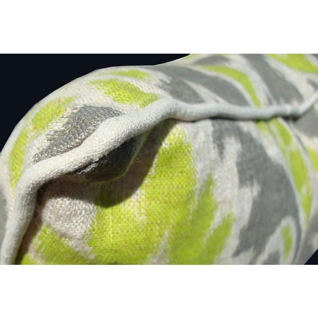 Just when we thought we couldn't love Ikat any more... This 100% linen pillow provides a fun pop of color. The gray and...