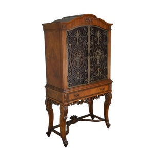 Renaissance Revival 1920's Carved Walnut Bar China Cabinet With Iron Doors For Sale