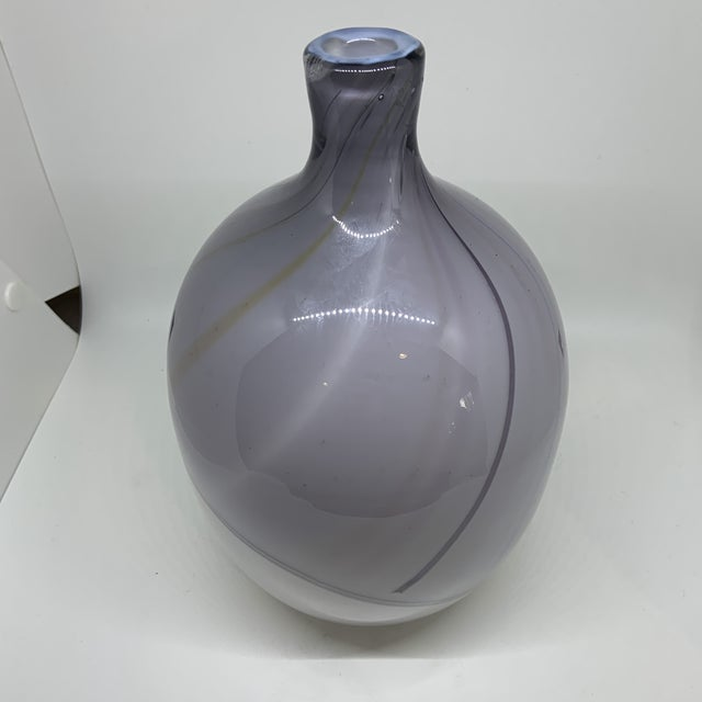 Large art glass piece in white and pale purple with a delicate pattern of striped lines. Made for Kosta Boda by Bengt...